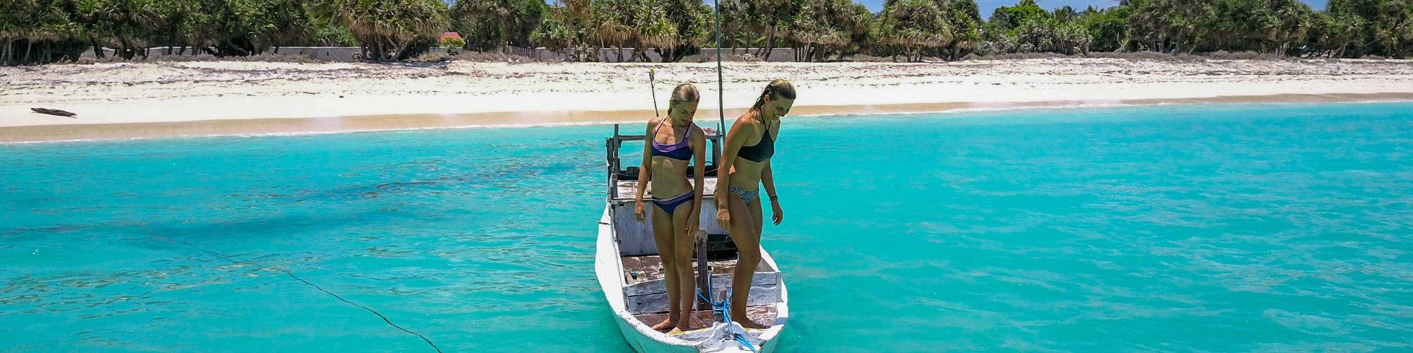 blue water white sand nemberala girls besialu indonesia rote island