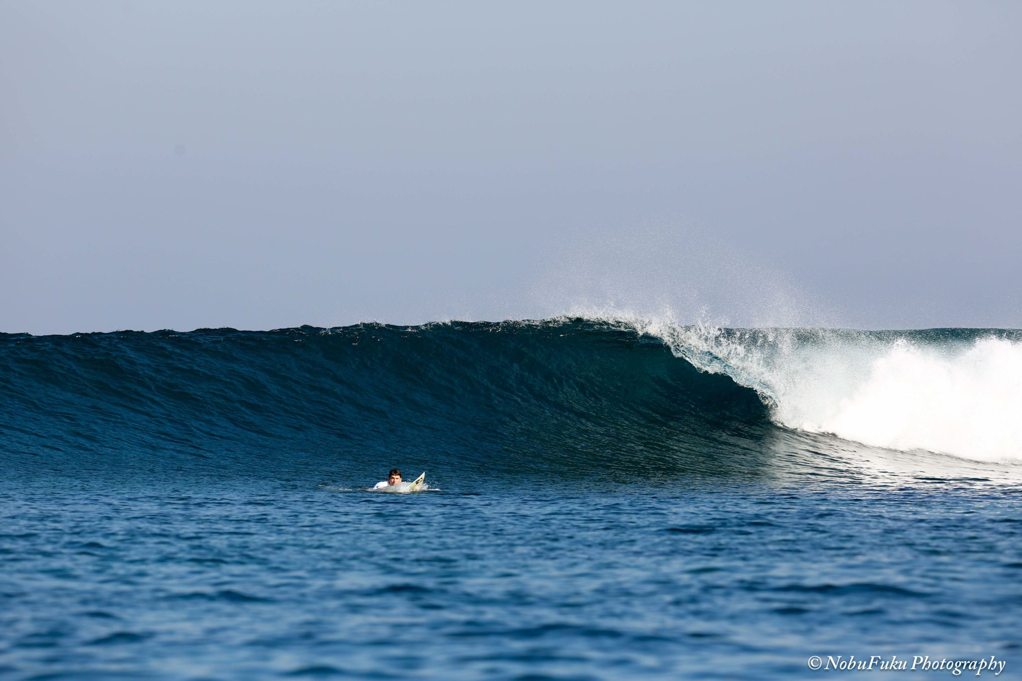 surfing the right hander surfbreak at Bo'a beach Rote island Indonesia